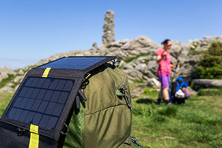 Rosie on the House solar charger on backpack